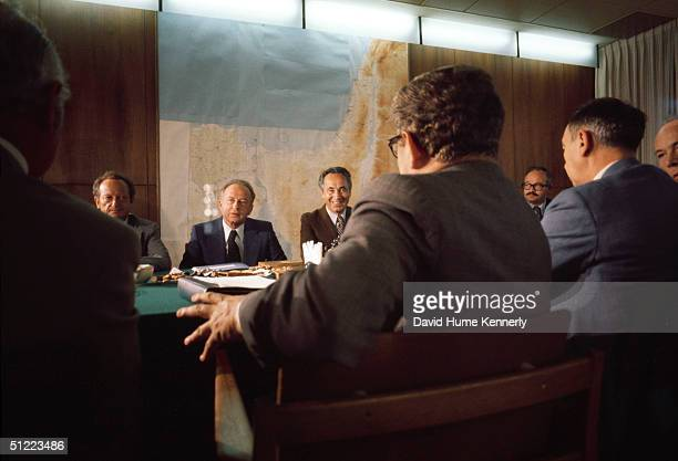 Across the table sits Israel's Foreign Minister Yigal Allon Prime Minister Itzhak Rabin and former Prime Minister Shimon Perez during the Sinai II...