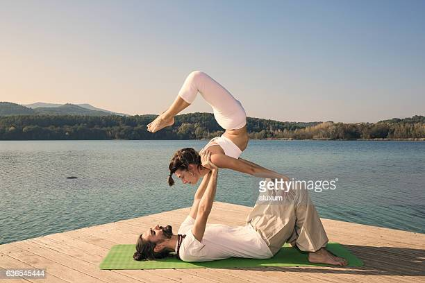 Acroyoga scorpion on knees pose