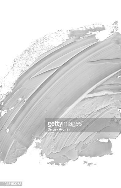acrylic paint smear with palette knife in gray - ölgemälde stock-fotos und bilder