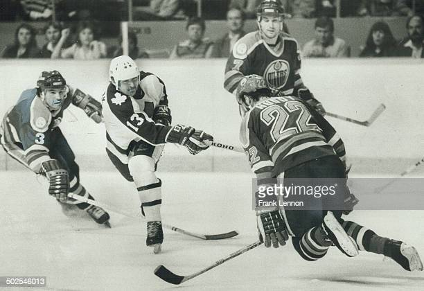 Act of bravery Defenceman Charlie Huddy of the Edmonton Oilers bravely puts his body in front of this slapshot by Toronto's Peter Ihnacak last night...