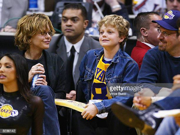 Actcress Meg Ryan and son Jack Quaid attend the game between the Los Angeles Lakers and the Portland Trailblazers on April 6 2004 in Los Angeles...