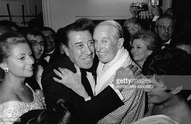 L'acteur Fernandel et le chanteur Maurice Chevalier en soirée