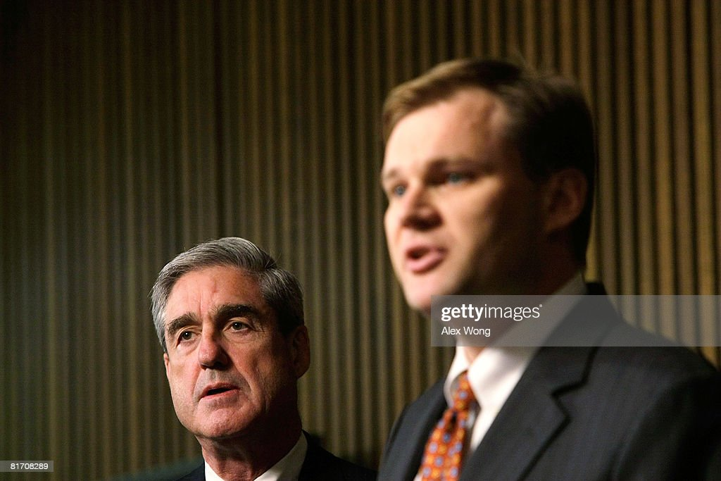 Acting Assistant Attorney General for the Criminal Division Matt Friedrich (R) speaks as FBI Director Robert Mueller (L) listens during a news conference at the FBI headquarters June 25, 2008 in Washington, DC. The news conference was to mark the 5th anniversary of Innocence Lost initiative.