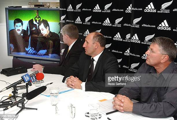 Acting CEO of the NZRFU Steve Tew left chairman Jock Hobbs and Adidas New Zealand manager Craig Lawson listen to a video from Germany head quarters...