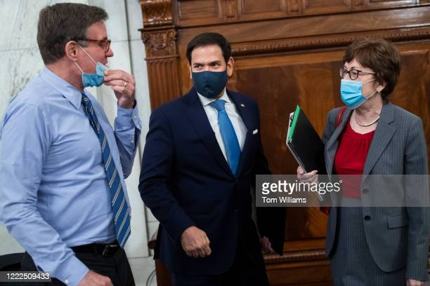 Acting Chairman Sen Marco Rubio RFla center vice chairman Sen Mark Warner DVa and Sen Susan Collins RMaine arrive for the Senate Select Intelligence...