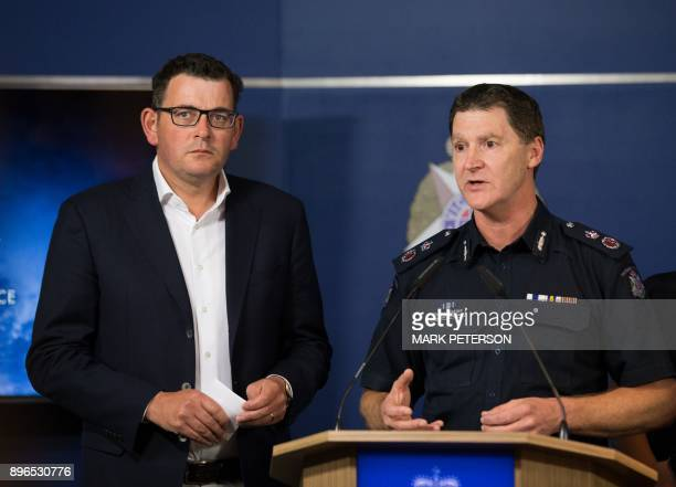 Acting chief commissioner Shane Patton speaks as Victoria's state premier Daniel Andrews listens during a press conference in Melbourne on December...
