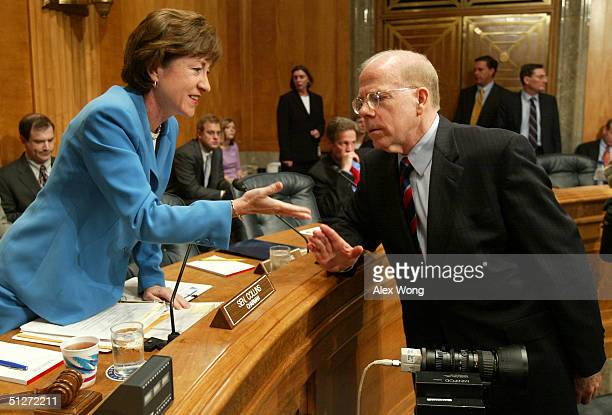 Acting CIA Director John McLaughlin talks to Chairman Senator Susan Collins prior to a hearing before the Senate Governmental Affairs Committee on...