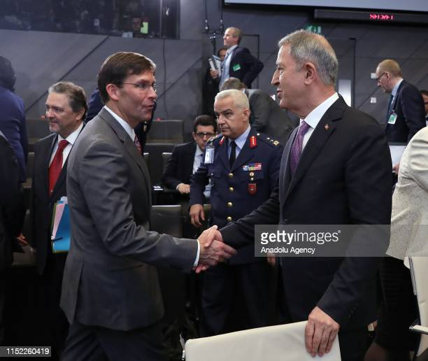 Acting Defense chief of United States Mark Esper shakes hand with Turkey's Minister of National Defence Hulusi Akar during the NATO Defense...