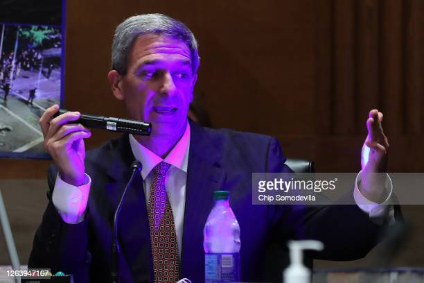 """Acting Deputy Secretary of Homeland Security Ken Cuccinelli demonstrates a """"commercial grade laser"""" while testifying before the Senate Judiciary..."""