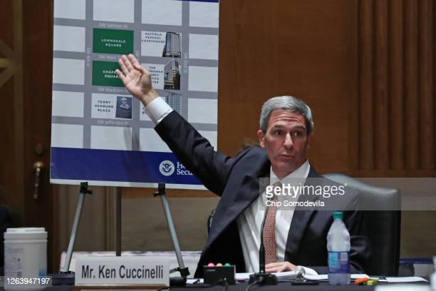 Acting Deputy Secretary of Homeland Security Ken Cuccinelli references a map of downtown Portland, Oregon, while testifying to the Senate Judiciary...