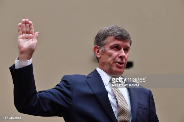 Acting Director of National Intelligence Joseph Maguire is sworn in before he testifies at a hearing of the House Permanent Select Committee on...