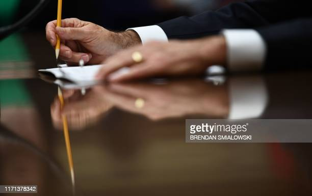 Acting Director of National Intelligence Joseph Maguire takes notes as he testifies before a hearing of the House Permanent Select Committee on...