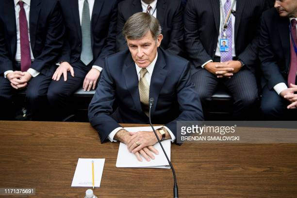 Acting Director of National Intelligence Joseph Maguire waits for a hearing of the House Intelligence Committee regarding a whistleblower complaint...