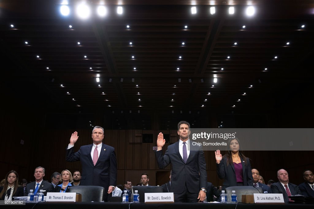 Acting Director of the Bureau of Alcohol, Tobacco, Firearms and Explosives Thomas Brandon, Acting Deputy Director of the Federal Bureau of Investigation David Bowdich and U.S. Secret Service's National Threat Assessment Center head Lina Alathari are sworn in before testifying to the Senate Judiciary Committee during a hearing about the massacre at Marjory Stoneman Douglas High School in the Hart Senate Office Building on Capitol Hill March 14, 2018 in Washington, DC. The witnesses testified about what more could have and should have been done to stop the school shooter Nikolas Cruz after law enformcement receieved several tips about him.