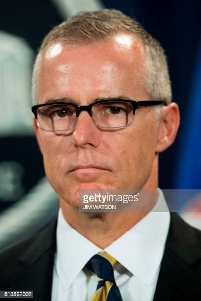 Acting Director of the Federal Bureau of Investigation Andrew McCabe speaks during a press conference at the US Department of Justice in Washington...