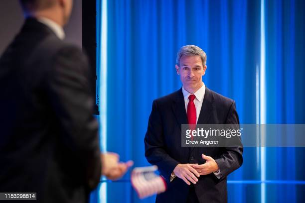 Acting Director of the U.S. Citizenship and Immigration Services Ken Cuccinelli leave the lectern after speaking during a naturalization ceremony...