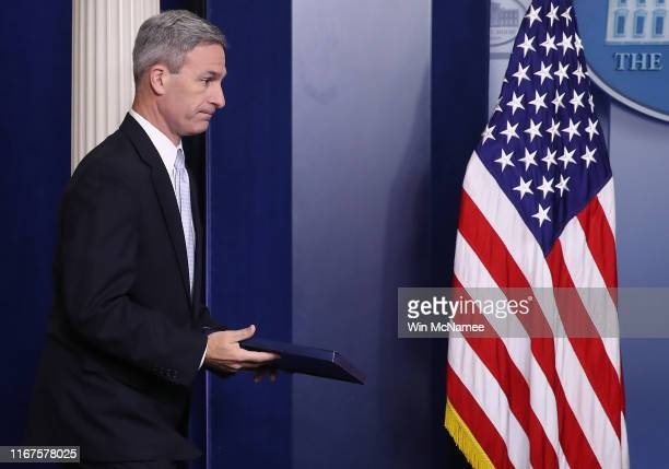 Acting Director of U.S. Citizenship and Immigration Services Ken Cuccinelli arrives at a White House briefing August 12, 2019 in Washington, DC....