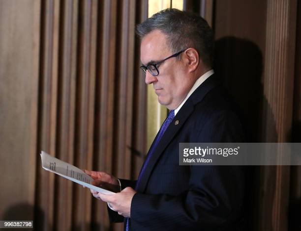Acting EPA Administrator Andrew Wheeler looks at his papers before speaking to employees at the Environmental Protection Agency headquarters on July...