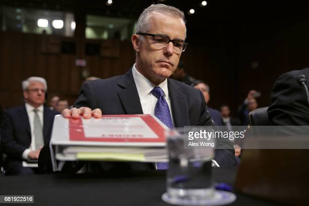 Acting FBI Director Andrew McCabe and the other heads of the US intelligence agencies prepare to testify before the Senate Intelligence Committee in...