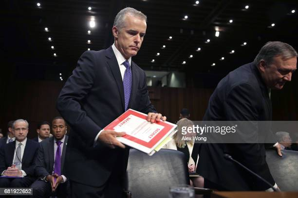 Acting FBI Director Andrew McCabe Central Intelligence Agency Director Mike Pompeo and the other heads of the US intelligence agencies prepare to...