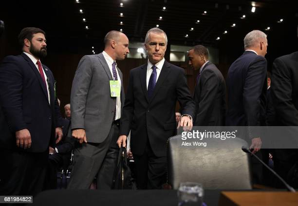 Acting FBI Director Andrew McCabe takes his seat as he arrives at a hearing before the Senate Intelligence Committee with the other heads of the US...