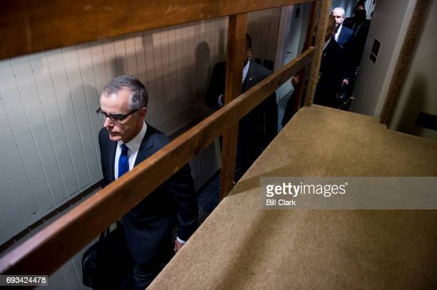 Acting FBI Director Andrew McCabe walks through a back hallway as he arrives in the Hart Senate Office Building to testify during the Senate Select...