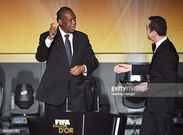 Acting FIFA President Issa Hayatou is greeted by host, James Nesbitt during the FIFA Ballon d'Or Gala 2015 at the Kongresshaus on January 11, 2016 in...