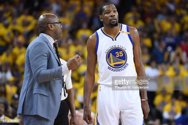 Acting head coach Mike Brown speaks with Kevin Durant of the Golden State Warriors during Game One of the NBA Western Conference Finals against the...