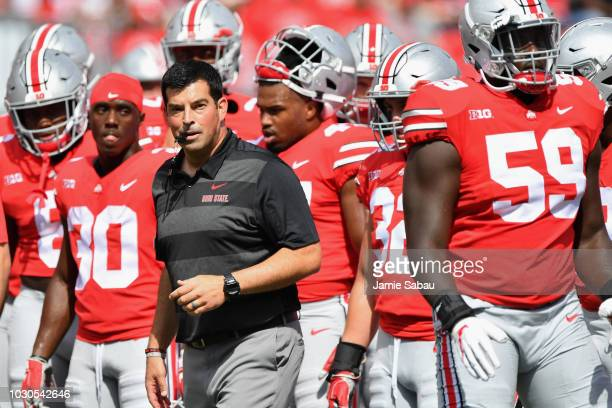 Acting Head Coach Ryan Day of the Ohio State Buckeyes watches his team warm up before a game against the Oregon State Beavers at Ohio Stadium on...