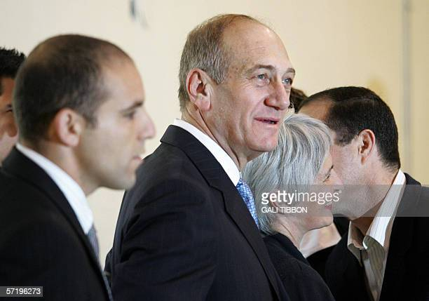 Acting Israeli Prime Minister and leader of the Kadima party Ehud Olmert arrives with his wife Aliza to vote in the Israeli general elections in...