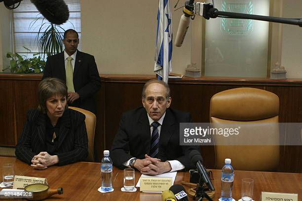 Acting Israeli Prime Minister Ehud Olmert and education minister Limor Livnat sit next to the empty chair of Ariel Sharon at the opening of a special...