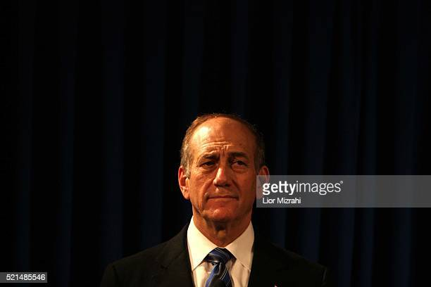 Acting Israeli Prime Minister Ehud Olmert looks on during a joint press conference with German Chancellor Angela Merkel in Jerusalem, Sunday January...
