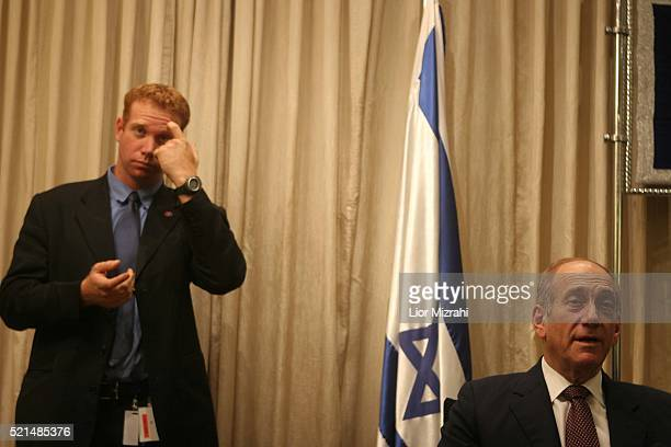 Acting Israeli Prime Minister Ehud Olmert, right, poses during a press conference with Israeli President Moshe at the President's residence in...