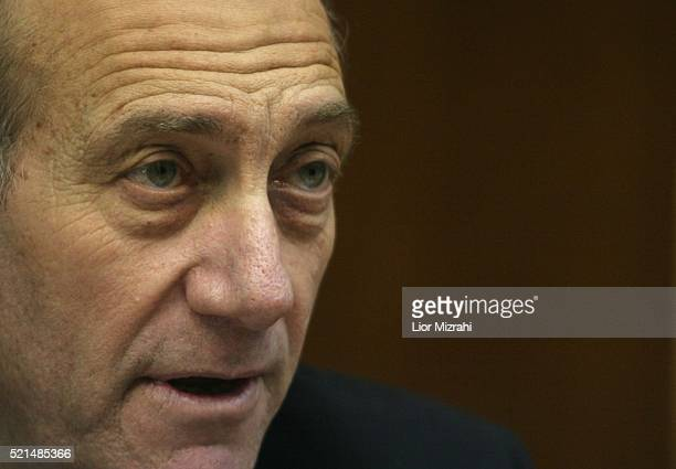Acting Israeli Prime Minister Ehud Olmert speaks at the opening of the weekly cabinet meeting in Jerusalem Sunday January 15 2006 Israeli Attorney...
