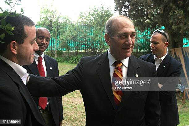Acting Israeli Prime Minister Ehud Olmert speaks to his bodyguards at his home in Jerusalem Tuesday, March 07, 2006. Olmert said Tuesday that his...