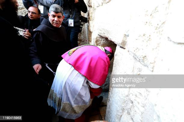 Acting Latin Patriarch of Jerusalem Pierbattista Pizzaballa arrives the Church of St Catherine to lead the ritual to mark Christmas in Bethlehem West...