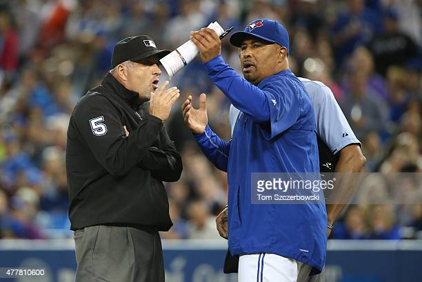 Acting manager DeMarlo Hale of the Toronto Blue Jays reacts after being ejected by home plate umpire CB Bucknor as he talks to second base umpire...