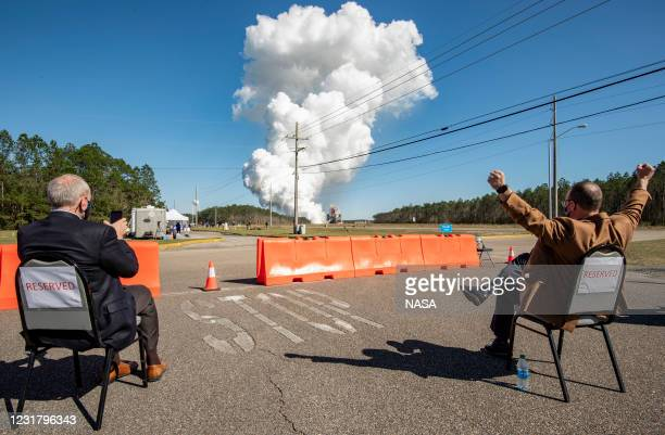 Acting NASA Administrator Steve Jurczyk, left, and Rick Gilbrech, director of NASA's Stennis Space Center, right, watch as the core stage for the...