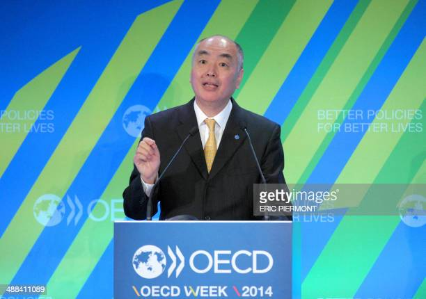 Acting OECD Chief Economist and Deputy Secretary General Rintaro Tamaki addresses the OECD on May 6 2014 to present the Economic Outlook at the OECD...