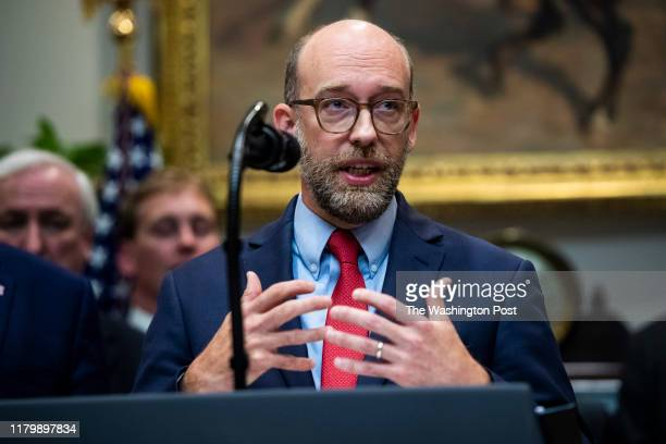 Acting Office of Management and Budget Director Russell Vought speaks with President Donald J Trump during a signing ceremony for Executive Orders on...