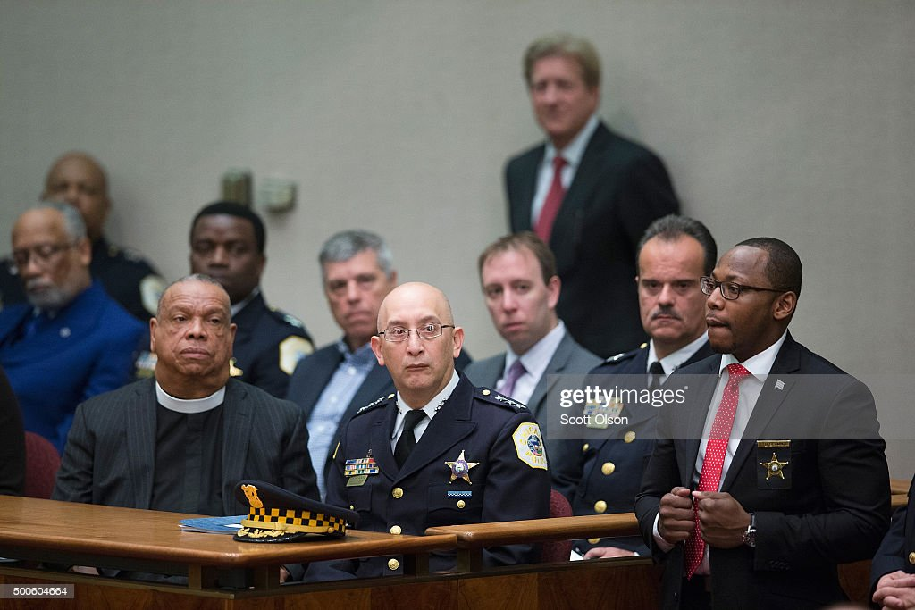 Acting Police Superintendant John Escalante (C) listens as Chicago Mayor Rahm Emanuel addresses a special session of the City Council as his administration continues to come under fire as allegation of extreme misconduct in the Chicago Police Department continue to surface on December 9, 2015 in Chicago, Illinois. Many people are calling for the mayor to resign, accusing him of trying to cover up the misconduct.