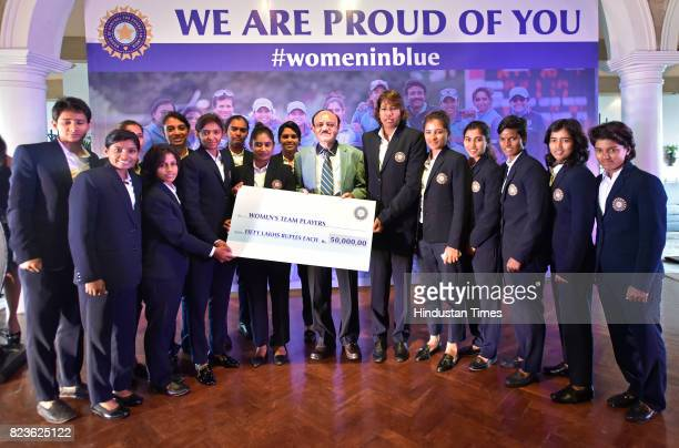 Acting President C K Khanna with India Women's Cricket team at a felicitating event at Taj Mansingh Hotel on July 27 2017 in New Delhi India Mithali...
