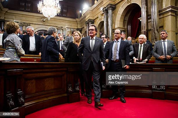 Acting President of Catalonia Artur Mas leaves the chamber at the end of the parliamentary session debating on his investiture as new President of...