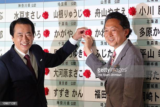 Acting President of Democratic Party of Japan Naoto Kan and the DPJ's SecretaryGeneral Yukio Hatoyama put flower to the names of the DPJ candidates...