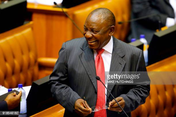 Acting President of South Africa Cyril Ramaphosa reacts as he arrives at Parliament in Cape Town on February 15 2018 for a session to officially deal...
