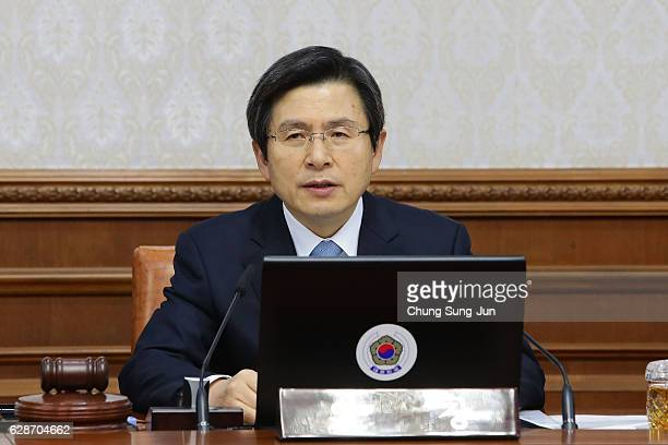 Acting President of South Korea Hwang KyoAhn attends the cabinet meeting after parliament passed the impeachment motion against President Park...