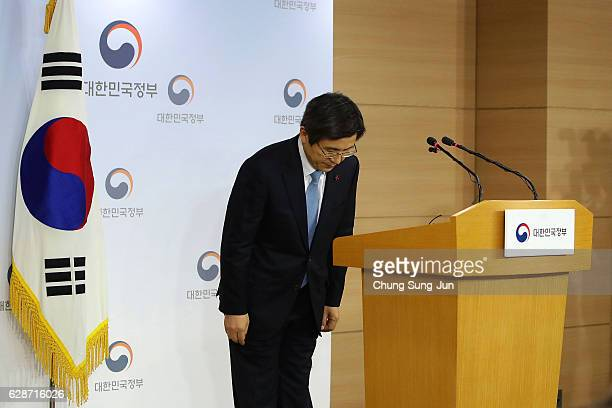 Acting President of South Korea Hwang KyoAhn bows after the statement to the nation after parliament passed the impeachment motion against President...
