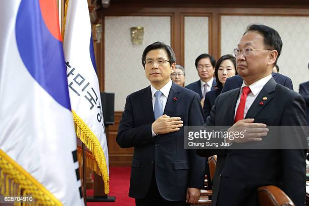 Acting President of South Korea Hwang KyoAhn gestures attends the cabinet meeting after parliament passed the impeachment motion against President...