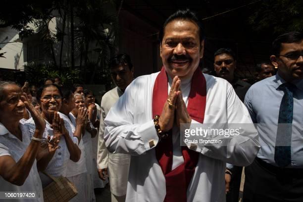 Acting Prime Minister Mahinda Rajapaksa leaves a temple near his home as the political turmoil deepens on November 11, 2018 in Colombo, Sri Lanka....