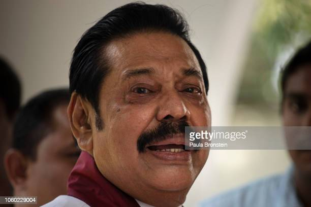 Acting Prime Minister Mahinda Rajapaksa reacts to members of his party and the media as he formally joins the Sri Lanka Freedom party as the...